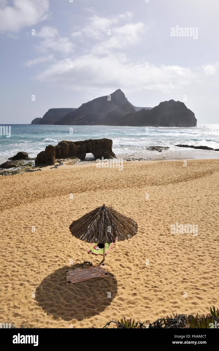 Ponta da Calheta beach and the Cal islet (Ilhéu da Cal). Porto Santo island, Madeira. Portugal - Stock Image