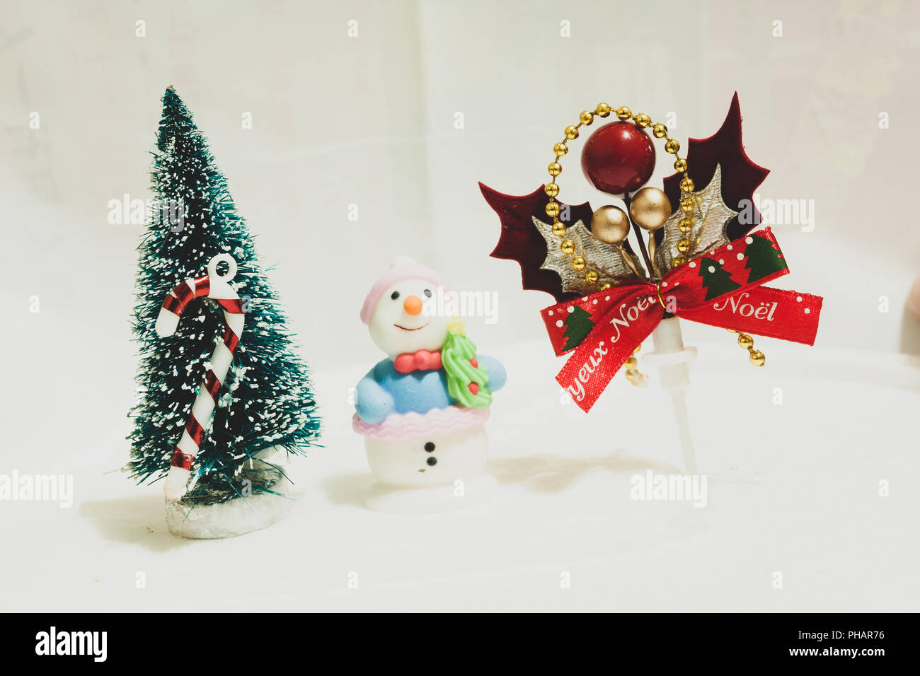Christmas cake toppers, mini ornaments, holiday tree, cute snowman;  berries, leaves and bow wreath. Vintage toned
