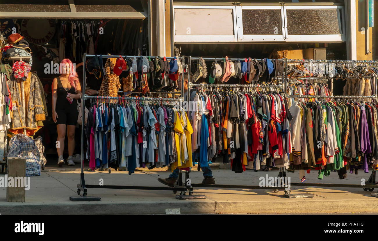 aad4a228328 Racks of a used clothing and other merchandise in the Williamsburg  neighborhood of Brooklyn in New