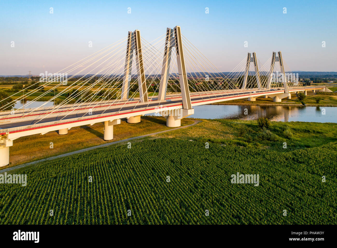 New modern double cable-stayed bridge over Vistula River in Krakow, Poland. Part of the ring motorway around Krakow under construction. Aerial view at Stock Photo