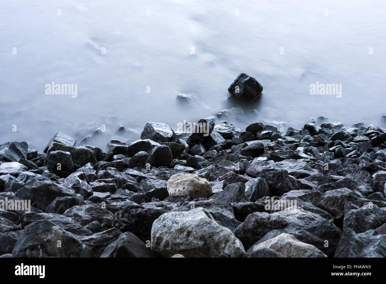 Same stone shore - Stock Image