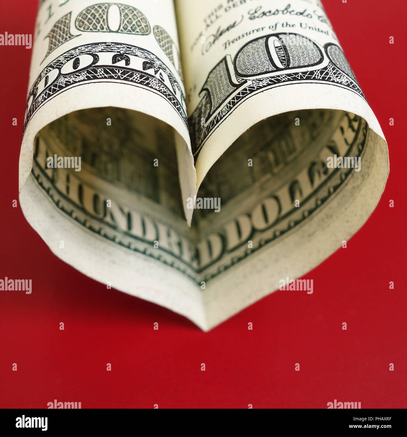 Hundred heart on red - Stock Image
