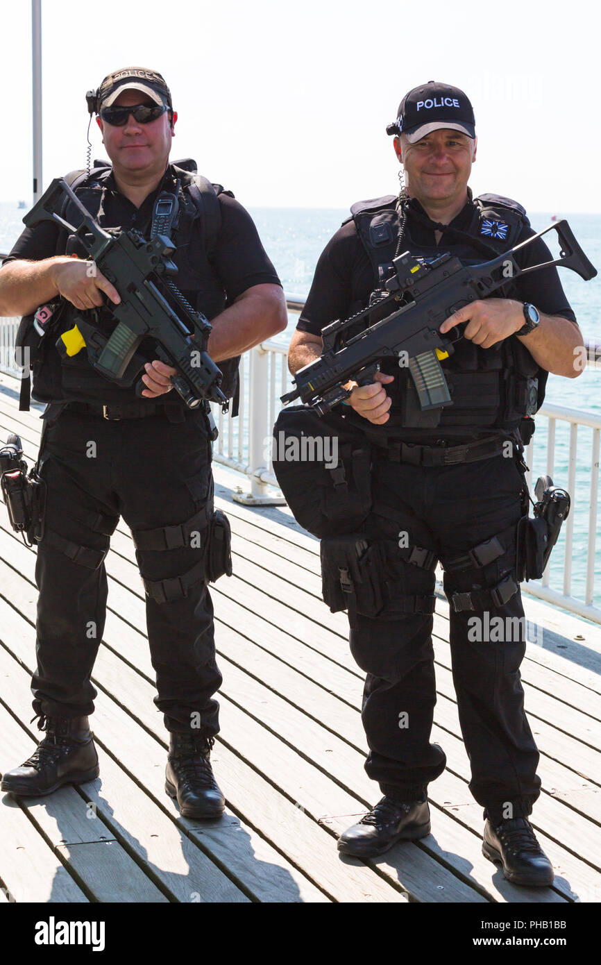 Bournemouth, UK. 31st August 2018. Crowds flock to Bournemouth for the 2nd day of the 11th annual Bournemouth Air Festival. Armed police on patrol. Credit: Carolyn Jenkins/Alamy Live News Stock Photo