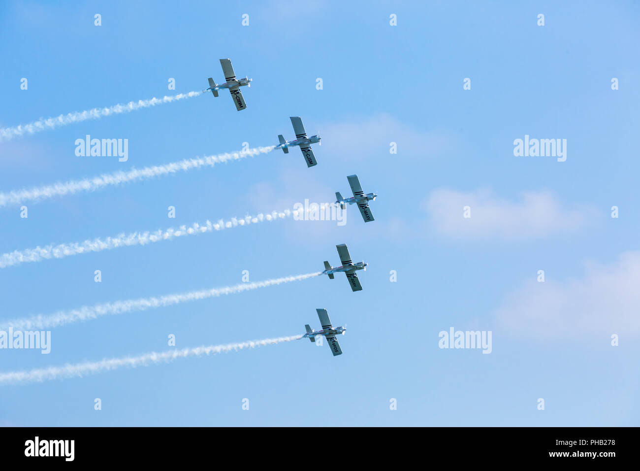 Bournemouth, UK. 31st August 2018. Crowds flock to Bournemouth for the 2nd day of the 11th annual Bournemouth Air Festival.  Team Raven thrill the crowds. Team Raven, aerobatic display team of 5 aircraft display for the first time at Bournemouth. Credit: Carolyn Jenkins/Alamy Live News Stock Photo