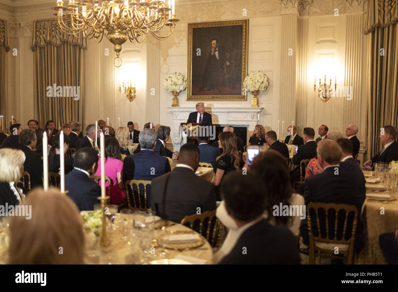 President Donald J Trump Addresses Guests On Monday August