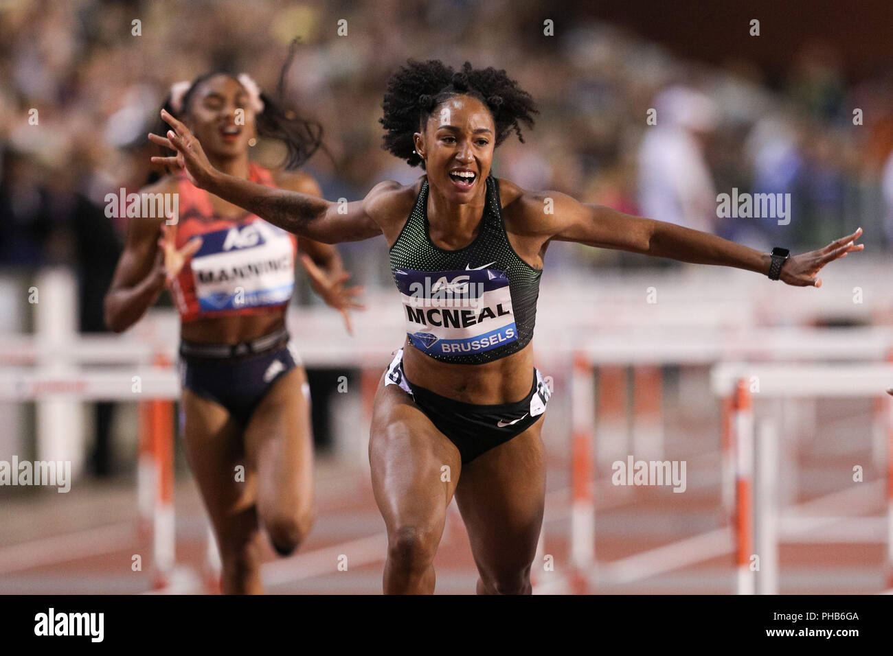 Brussels, Belgium. 31st Aug, 2018. Brianna McNeal (Front) of the United States celebrates after the women's 100m hurdles at the IAAF Diamond League athletics meeting in Brussels, Belgium, Aug. 31, 2018. Brianna McNeal claimed the title in a time of 12.61 seconds. Credit: Zheng Huansong/Xinhua/Alamy Live News - Stock Image