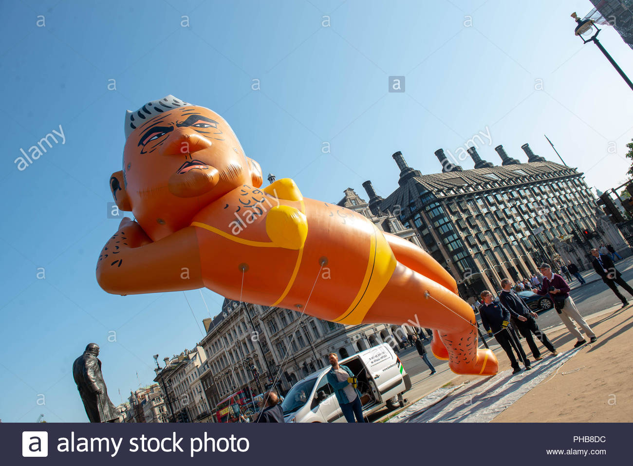 London, UK. 1st September 2018. A blimp of Sadiq Khan wearing a yellow bikini flew over Westminster on Saturday morning. The event is a  response to the Donald Trump baby balloon that the London mayor permitted in July.  Credit: David Nash/Alamy Live News - Stock Image
