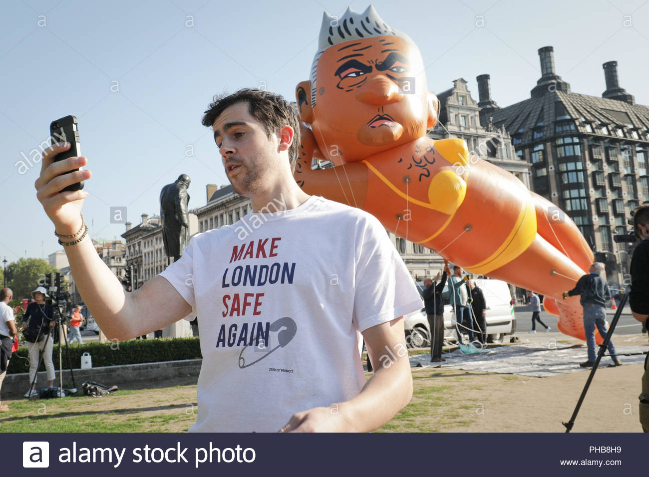 London, UK. 1st September 2018. Yanny Bruere the blimp organiser and free speech advocate takes a selfie. Giant blimp of London Mayor Sadiq Khan wearing a yellow bikini is inflated ready to fly over Parliament square. Credit: Guy Corbishley/Alamy Live News - Stock Image