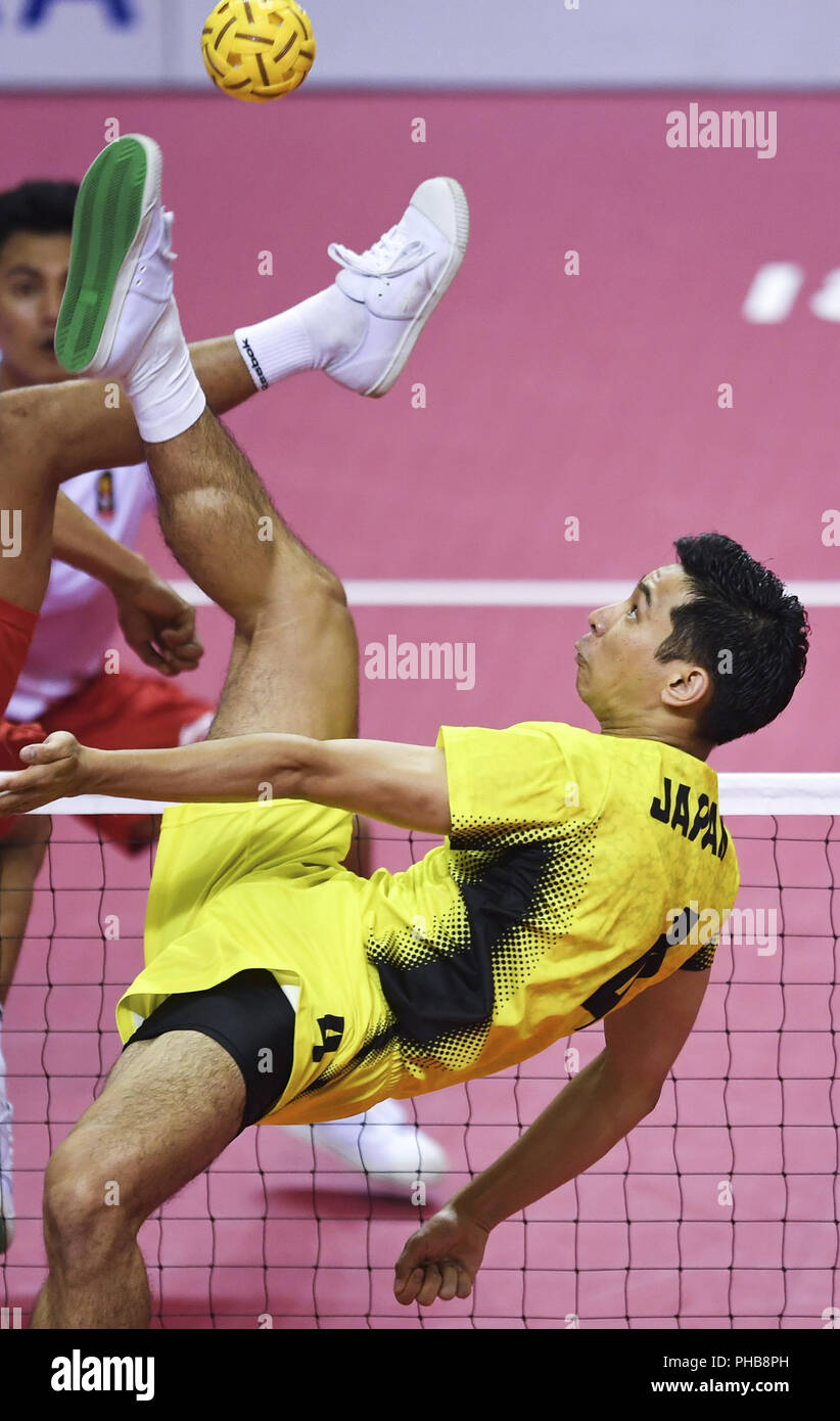 (180901) --PALEMBANG, Sept. 1, 2018 (Xinhua) -- Naito Toshitaka of Japan competes during Sepaktakraw Men's Quadrant Gold Medal Match between Indonesia and Japan in Palembang, Indonesia Sept. 1, 2018. Indonesia won 2-1. (Xinhua/Liu Ailun) - Stock Image