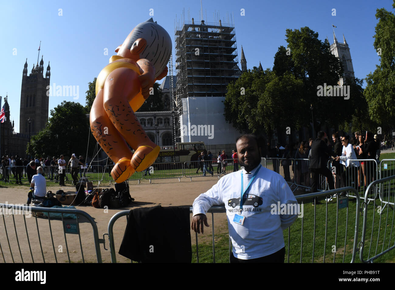 Alt-Right,  anti-Mayor of London take the revenge after Trump baby with a 29ft Gaint ballon of a Bikini-clad Sadiq Khan blimp to fly over London at Parliament Square on 1st September 2018, London, UK. - Stock Image