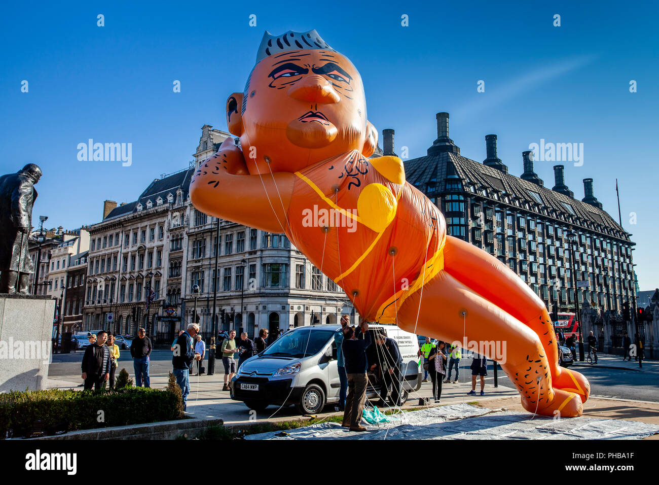 London, UK. 1st September 2018. Protesters fly a 29ft long bikini-clad blimp of London mayor Sadiq Khan over Parliament Square, Westminster. Credit: Grant Rooney/Alamy Live News - Stock Image