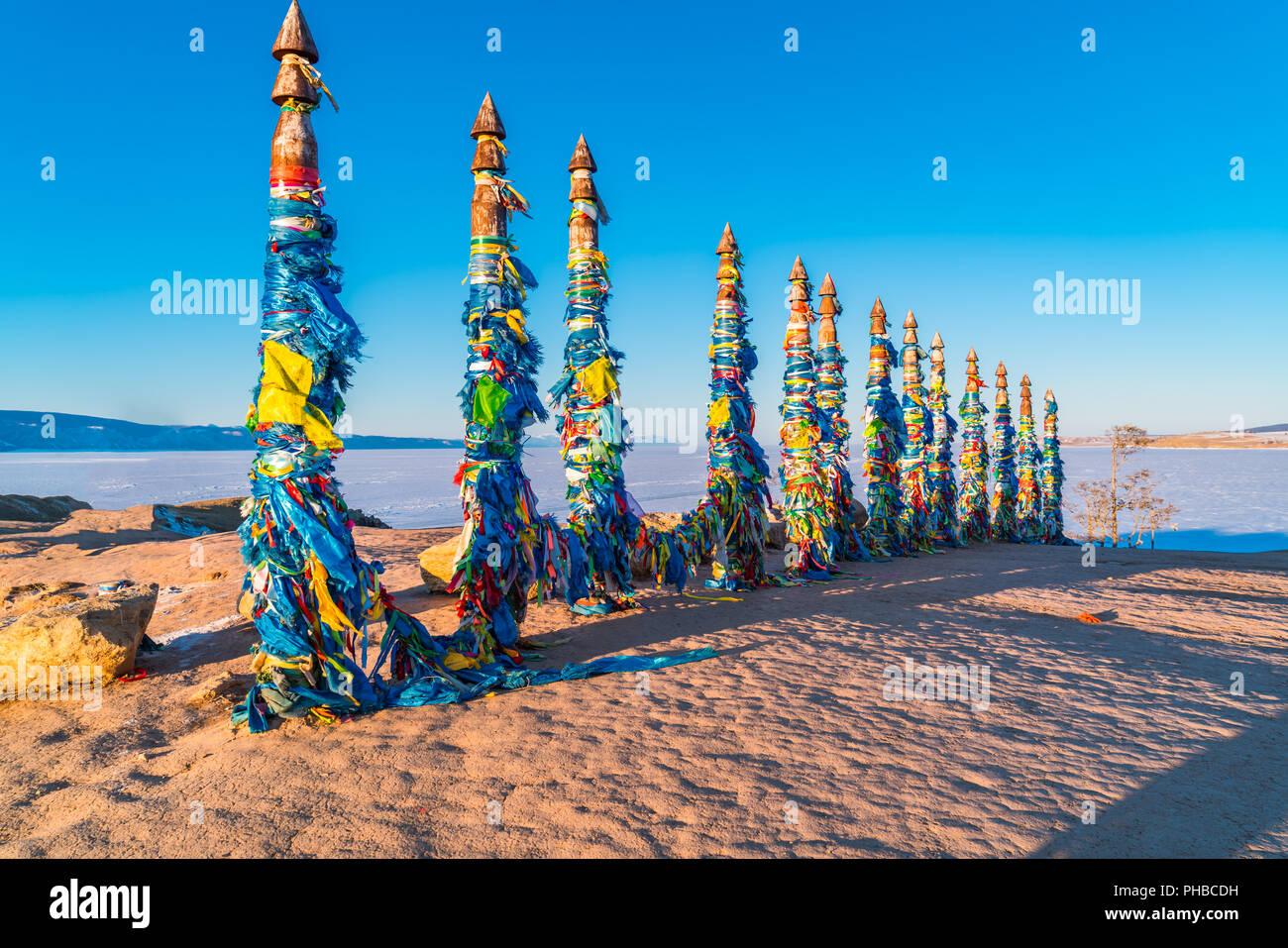 Shaman totem poles at Cape Burkhan on Olkhon Island - Stock Image