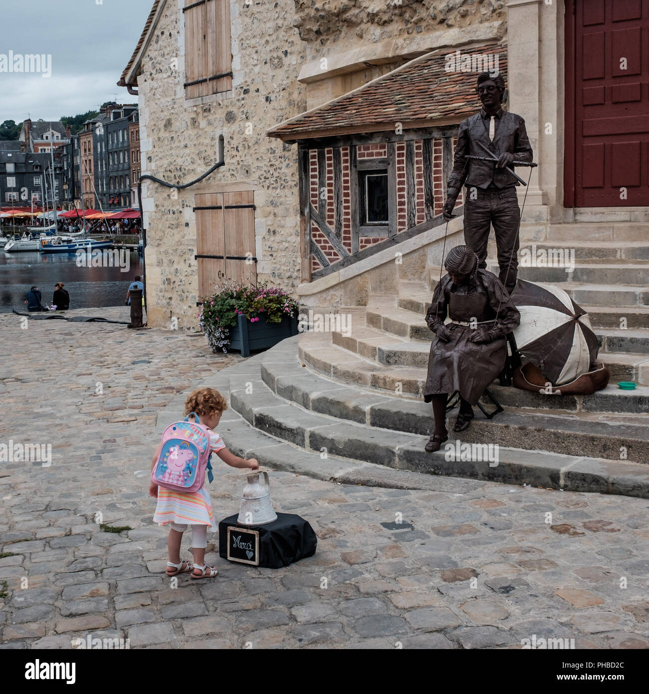 Child and living statues in the famous village of Honfleur, Wednesday 23 August 2017, Honfleur, Normandy, France. - Stock Image