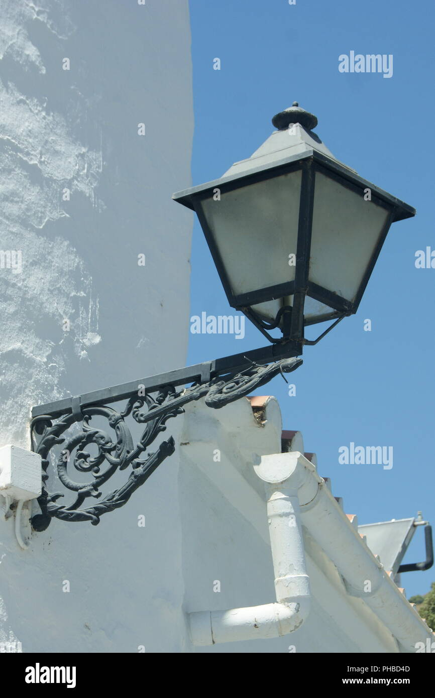 Spain, Frigliana, Andalusia, and old fashioned street lamp set against the intense blue sky - Stock Image