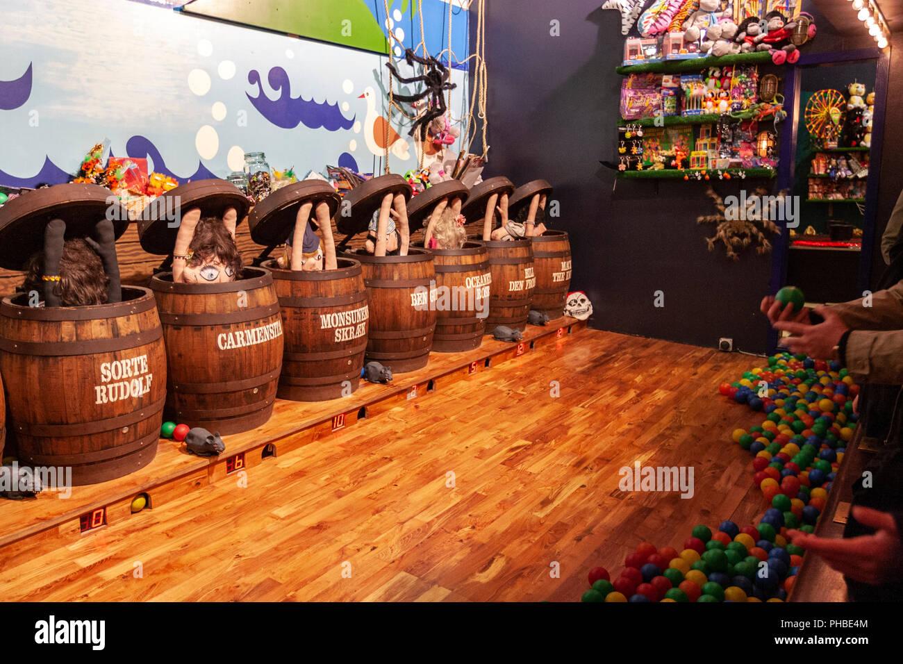 Ball gale throwing to barrels during Halloween in Tivoli Gardens amusement park and pleasure garden, Copenhagen, Denmark - Stock Image