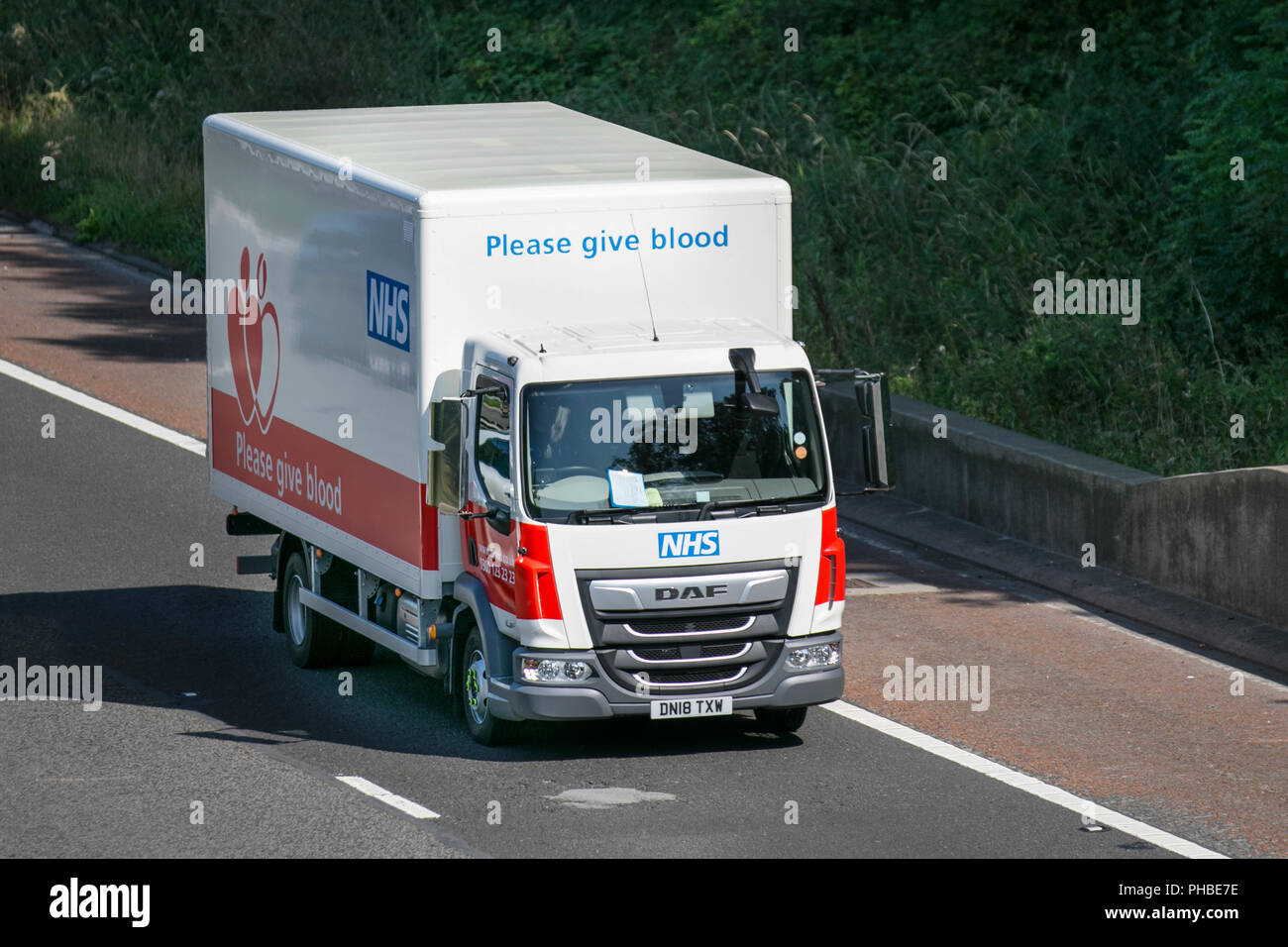 NHS  Blood Transfusion vehicle, DAF LF on the M6; Heavy Haulage, Lancaster, UK Stock Photo