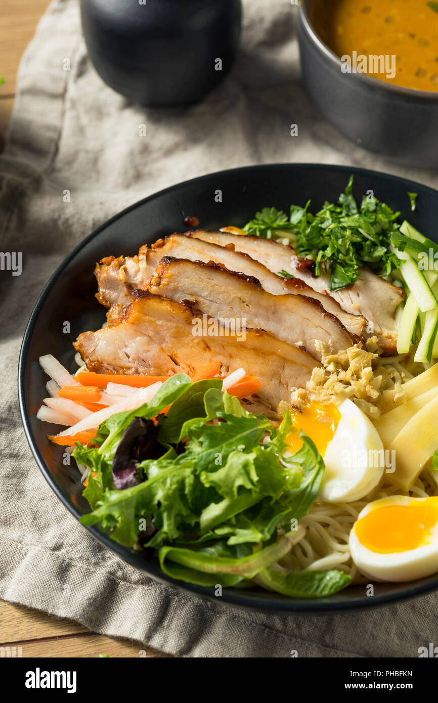 Homemade No Broth Mazemen Ramen with Pork Belly and Veggies Stock Photo