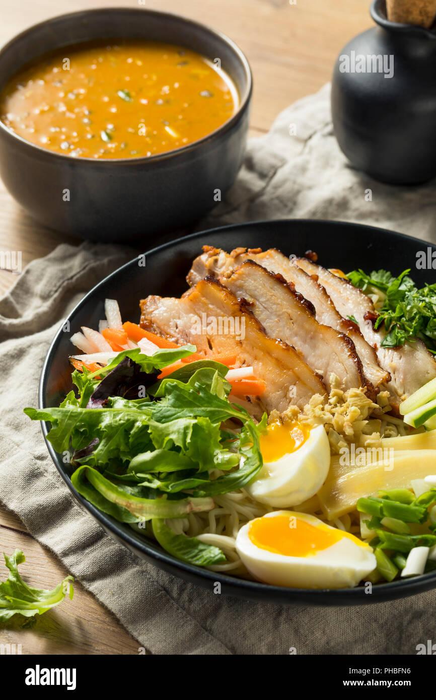 Homemade No Broth Mazemen Ramen with Pork Belly and Veggies Stock Photo