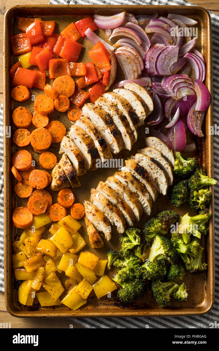 Homemade Keto Sheet Pan Chicken with Rainbow Vegetables - Stock Image