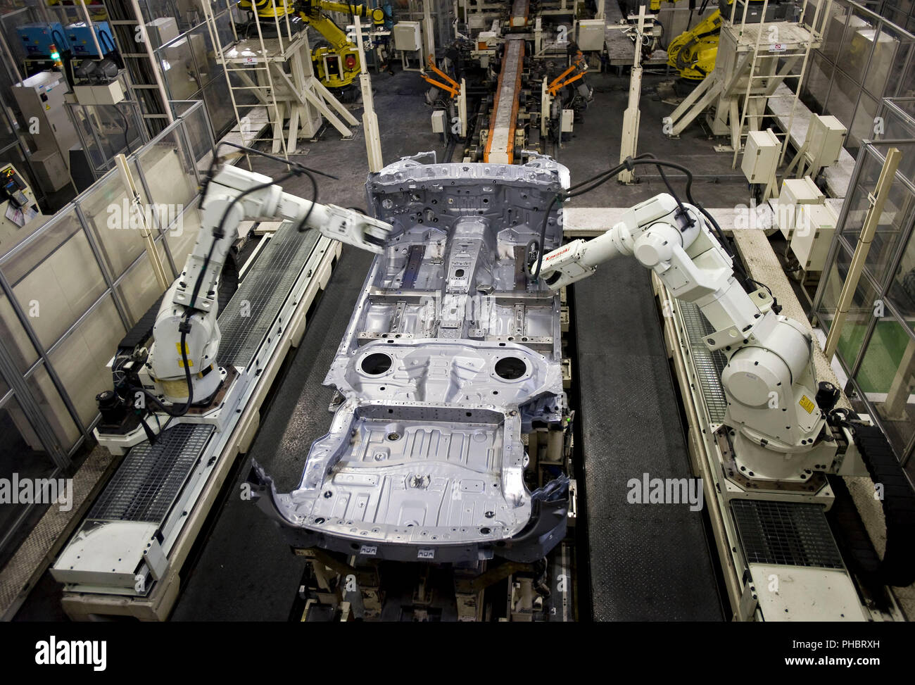 Robots work on a vehicle at Nissan Motor Co.s assembly plant in Tochigi, Japan on Thursday 12 Nov.  2009.  Photographer: Robert Gilhooly Stock Photo