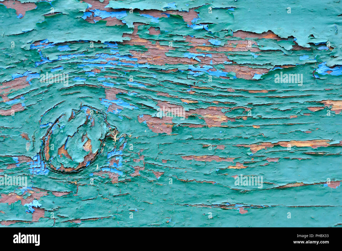 Old wooden painted blue planks, paint peeling background - Stock Image