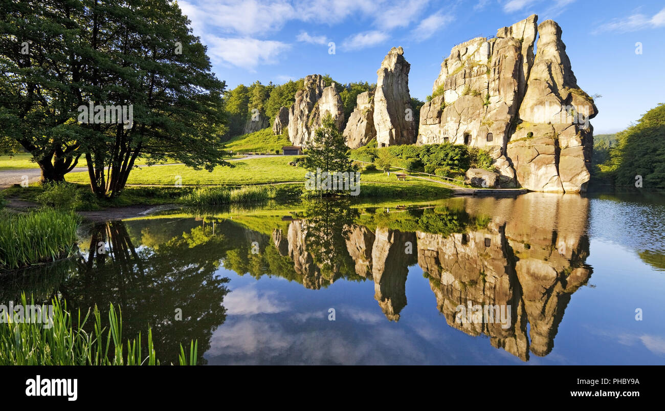 Externsteine, mirroring in a lake, Horn-Bad Meinberg, North Rhine-Westphalia, Germany, Europe - Stock Image