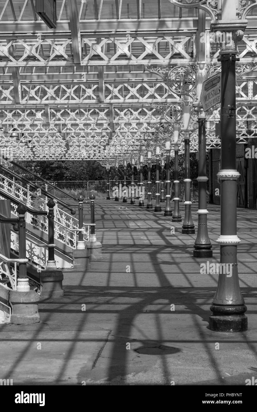Interesting patterns of strucures and their shadows at Tynemouth Station in black and white Stock Photo