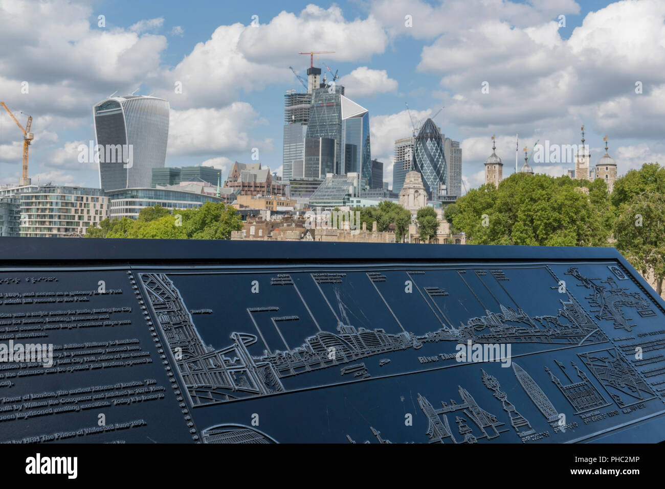 city of london skyline viewed from tower bridge with an information plaque or buildings map in the foreground. - Stock Image