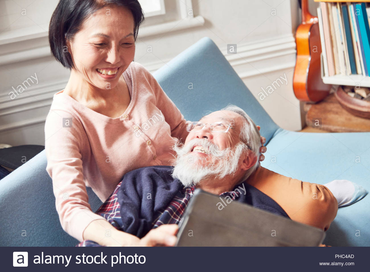 Senior couple using digital tablet together - Stock Image