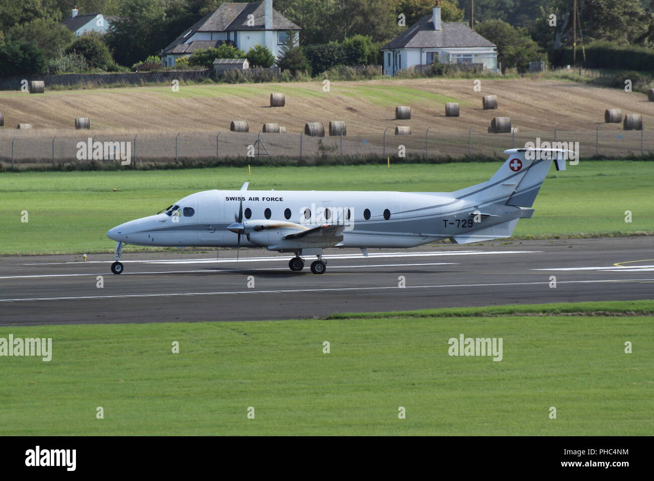 T-729, a Beechcraft 1900D operated by the Swiss Air Force, at Prestwick International Airport in Ayrshire. - Stock Image