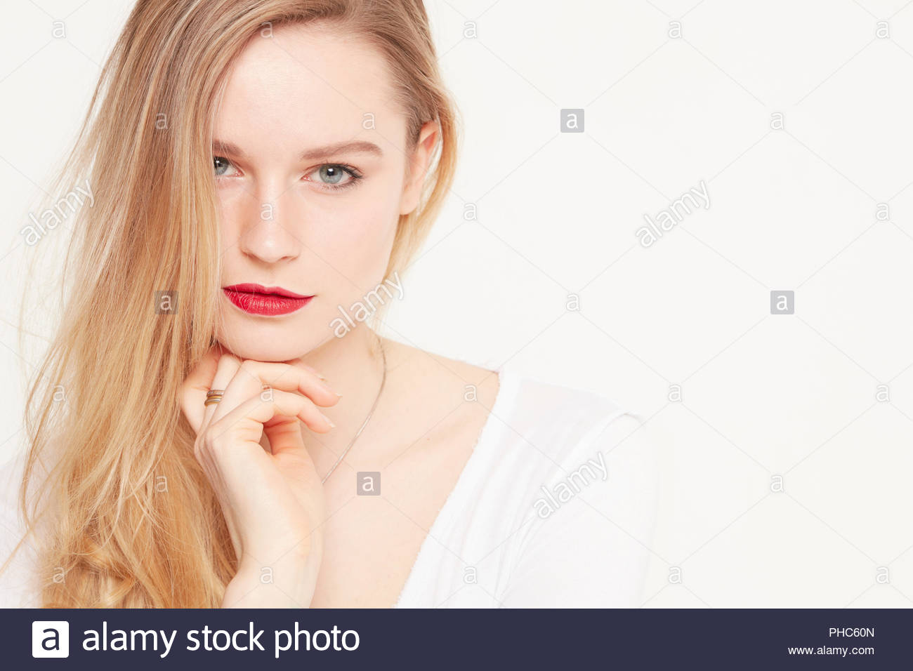 Portrait of young woman wearing red lipstick Stock Photo