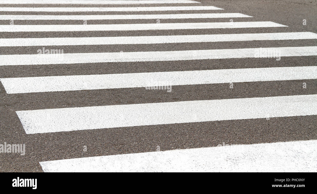 A worn-out pedestrian crossing - Stock Image