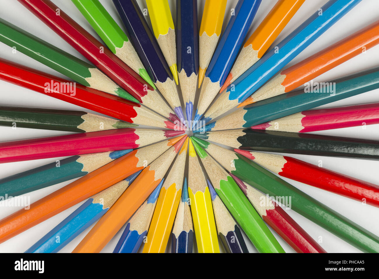 Color circle of pencils with complementary colors - Stock Image