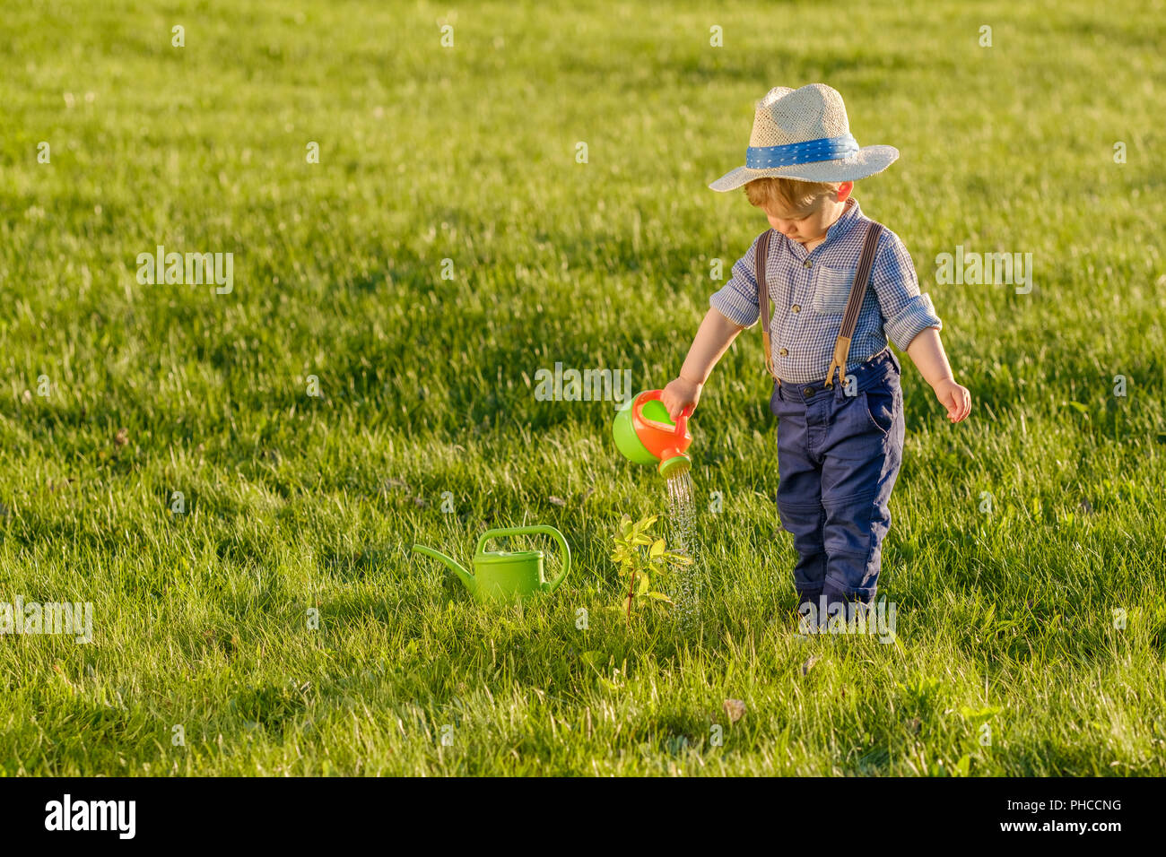 Little Boy Wearing Cowboy Hat Stock Photos   Little Boy Wearing ... 0971284c235