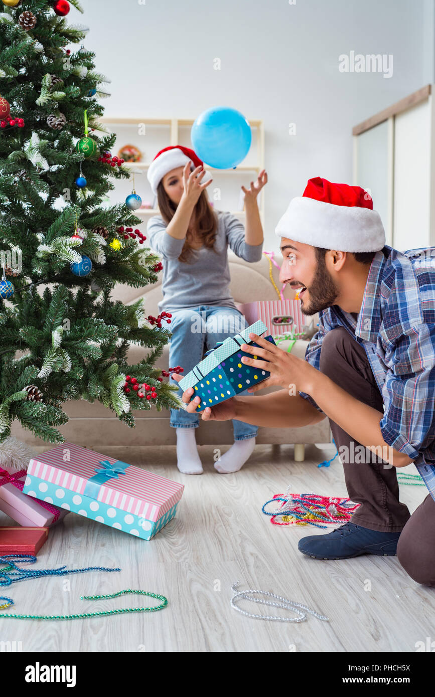 The girlfriend and boyfriend opening christmas gifts Stock Photo ...