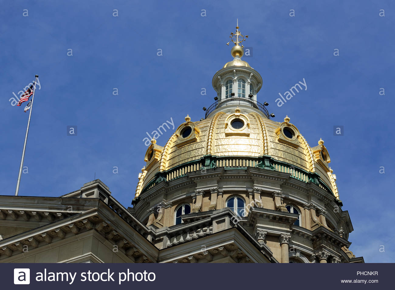 The Iowa State Capitol dome gleams in the sunlight. The beautiful dome has stood over Des Moines since 1886. - Stock Image