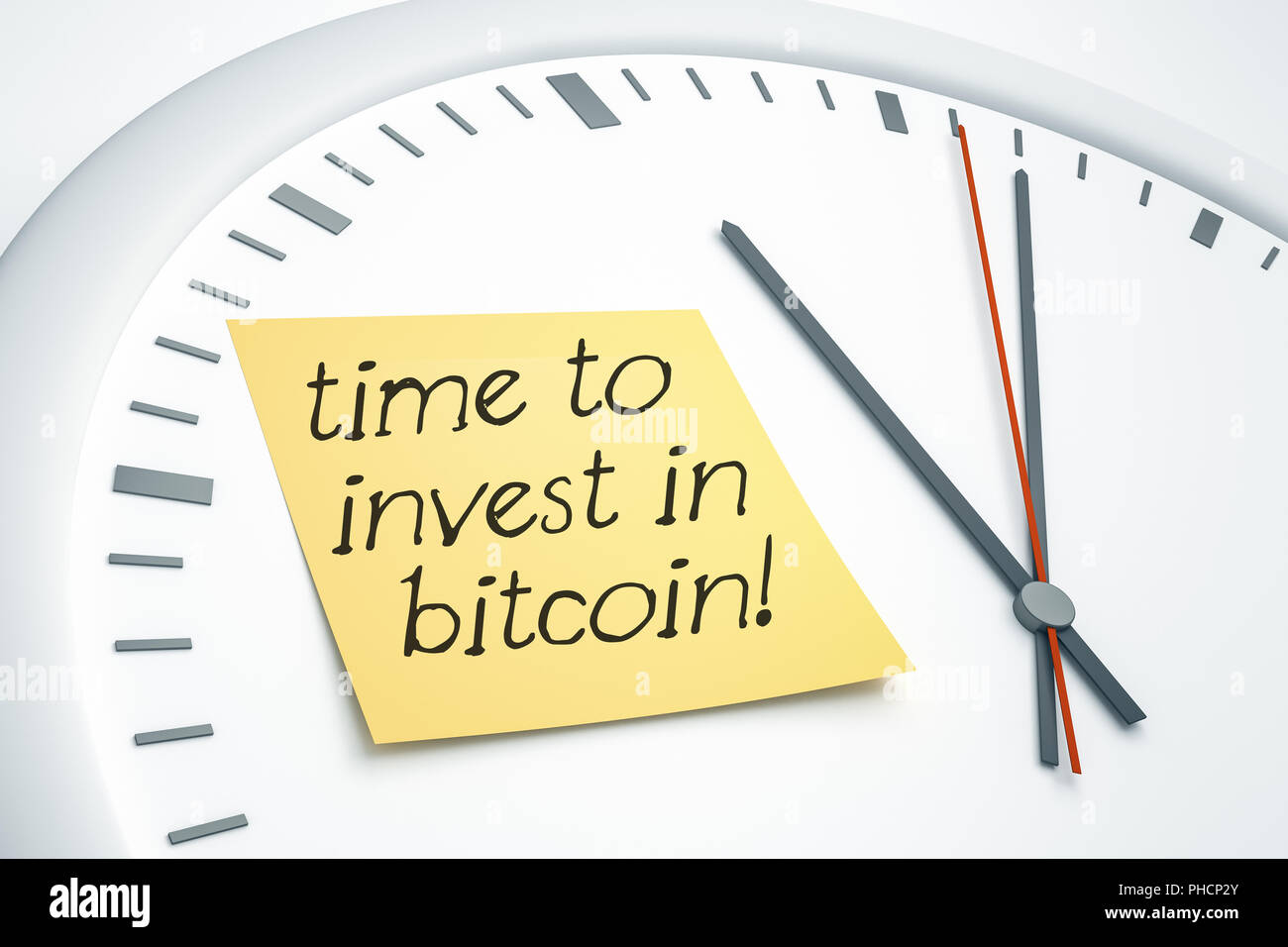 clock with sticky note time to invest in bitcoin - Stock Image