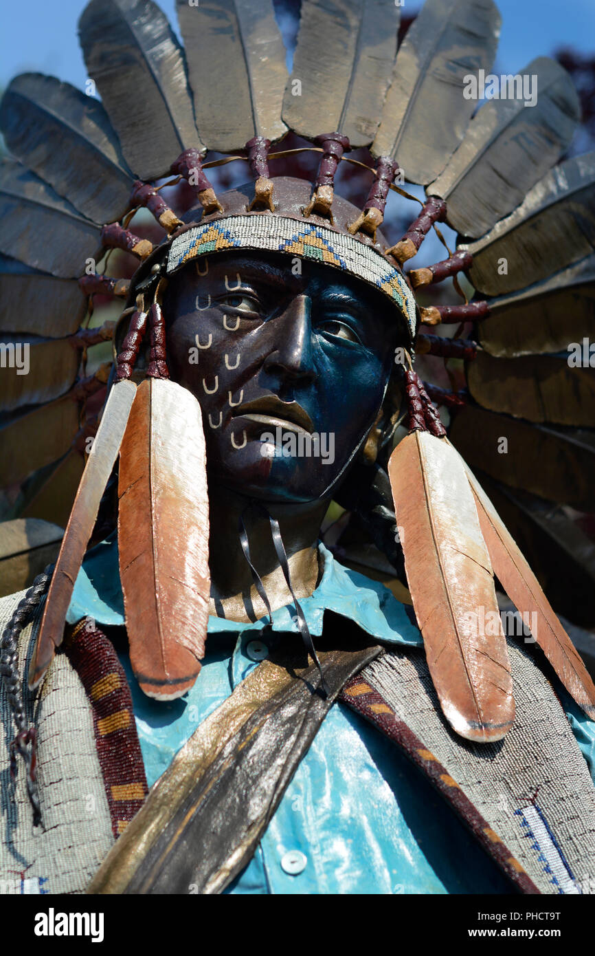 A bronze sculpture of a Native American warrior (Iroquois) in an art gallery in Santa Fe, New Mexico USA - Stock Image