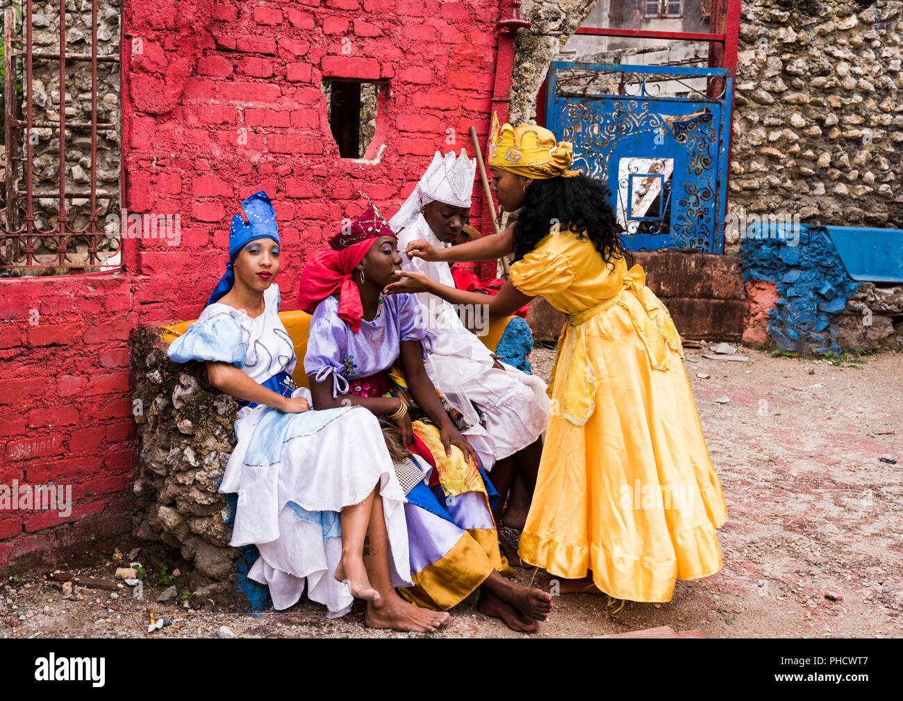 Havana, Cuba / March 20, 2016: Four Cuban women prepping before Santeria performance at Hamel Alley. - Stock Image