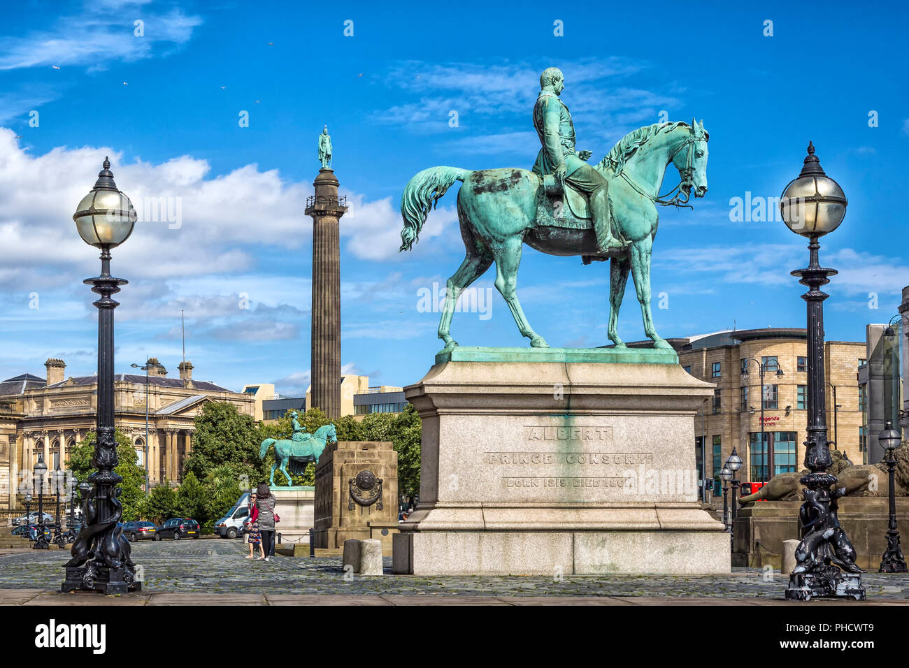 The statue of Prince Albert Consort on horseback positioned between old victorian street lamps. - Stock Image