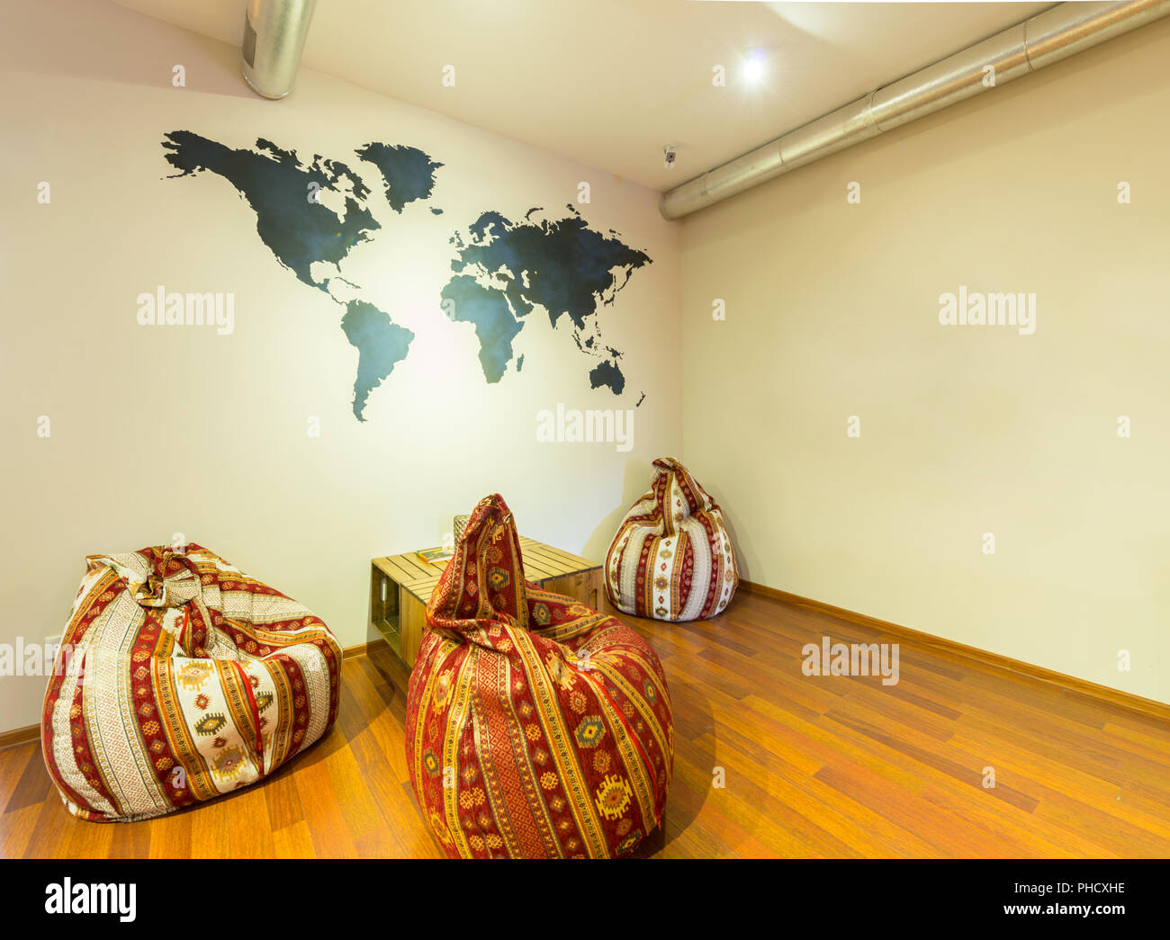 Waiting area in hotel with bean bag chairs - Stock Image