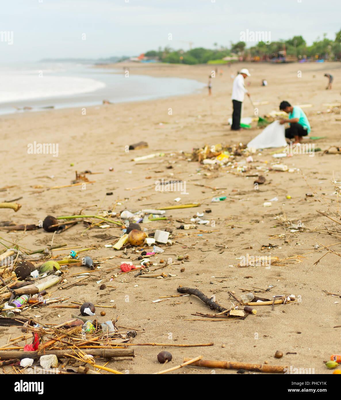 Polluted ocean beach. Bali - Stock Image