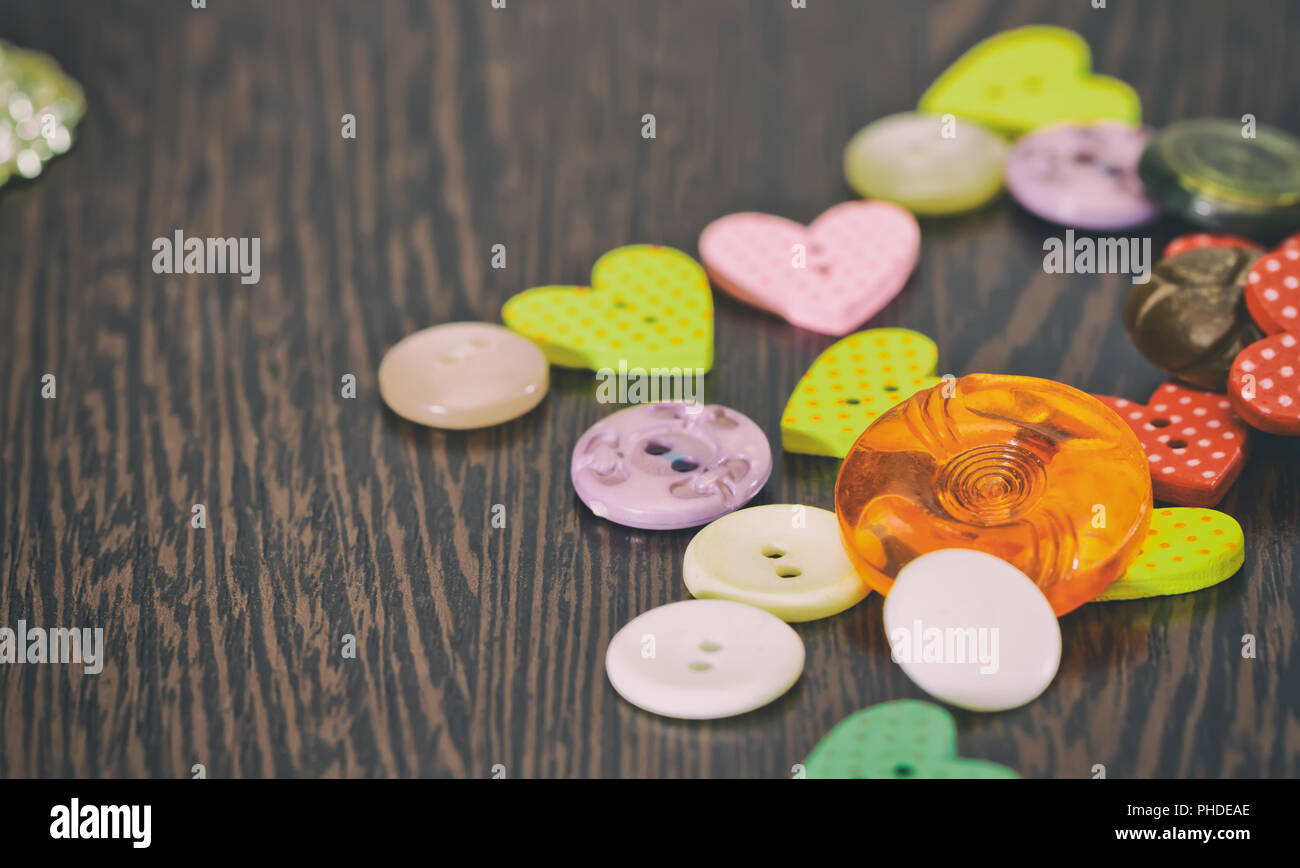Buttons dark tones are on the table - Stock Image