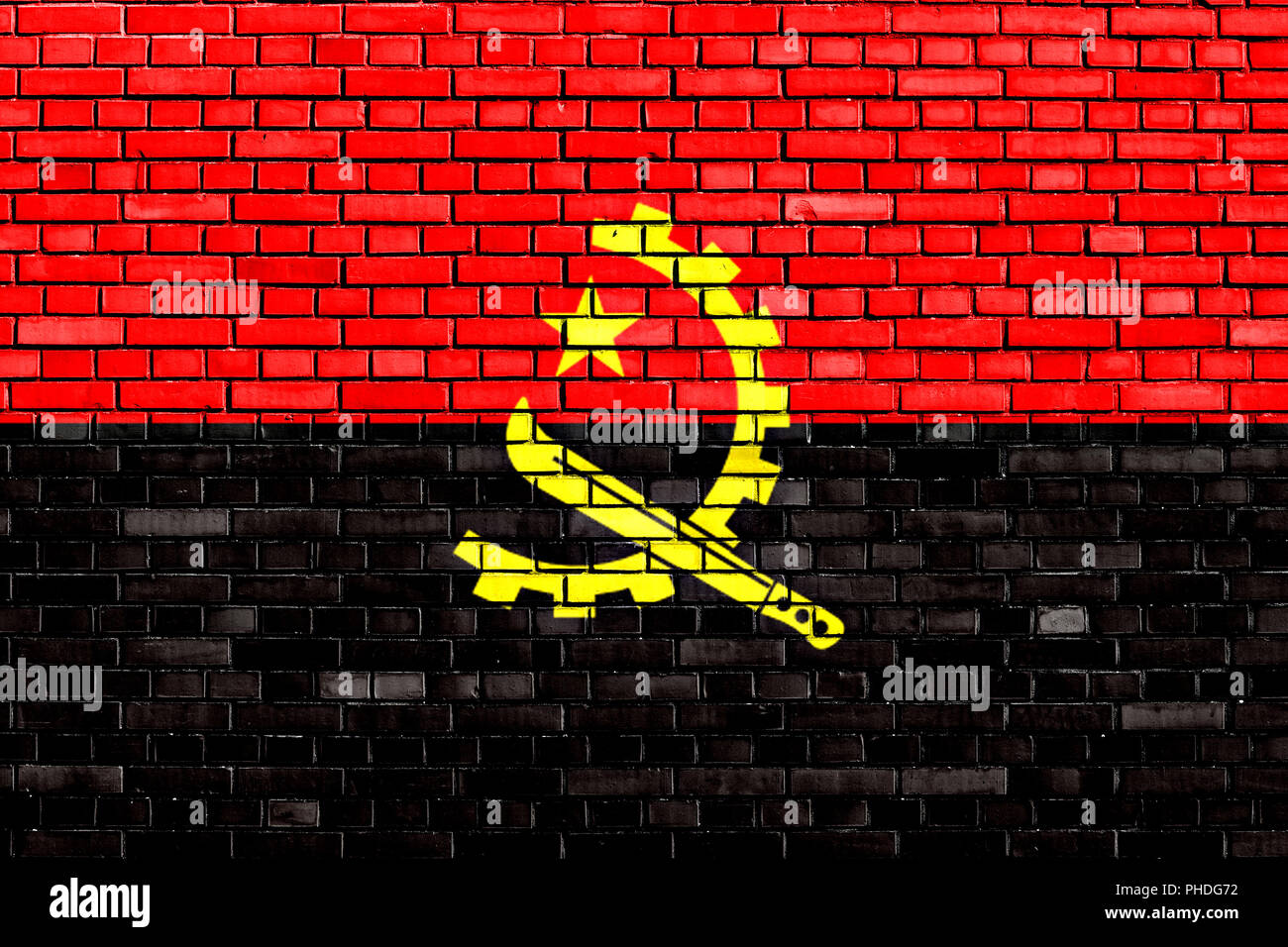 flag of Angola painted on brick wall - Stock Image