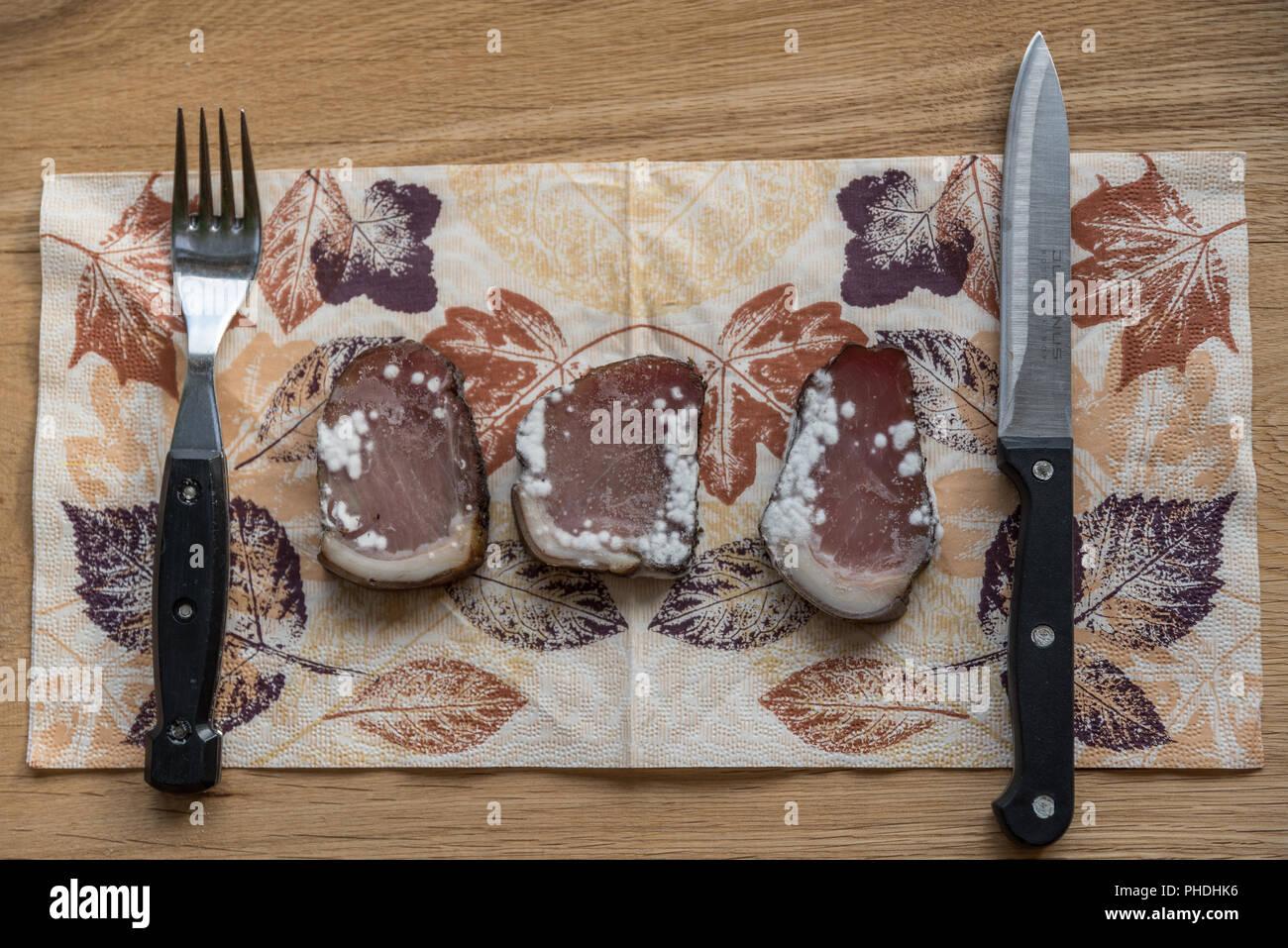 rotten bacon shows mold spores - Stock Image