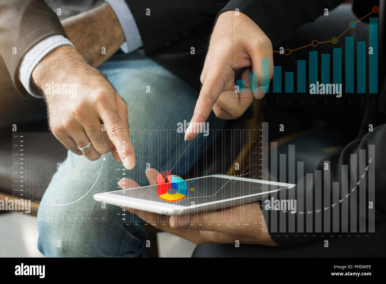 group of business people discussing about finance of capital banking and pointing at tablet. - Stock Image