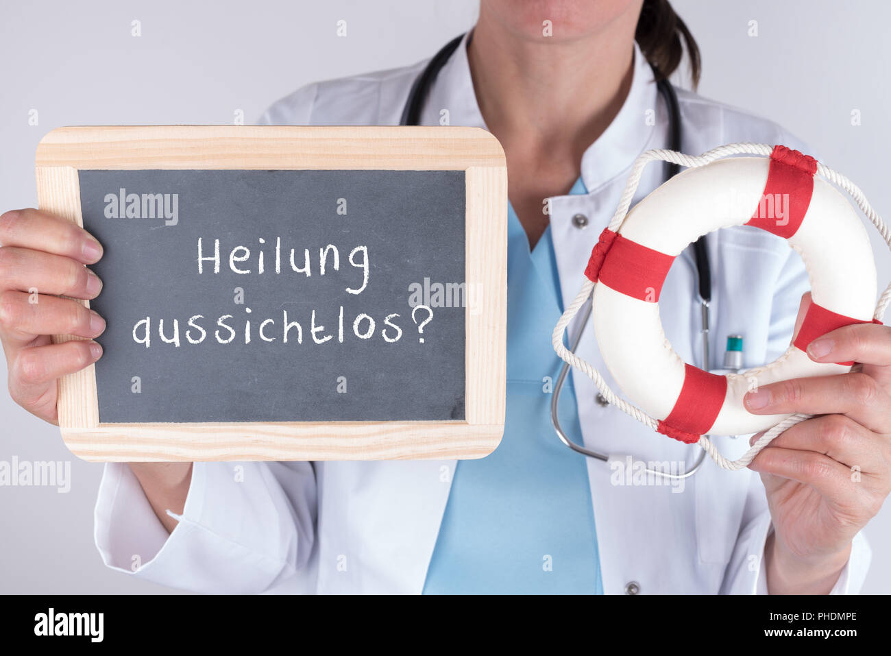 Doctor with blackboard healing hopeless and life belt - Stock Image