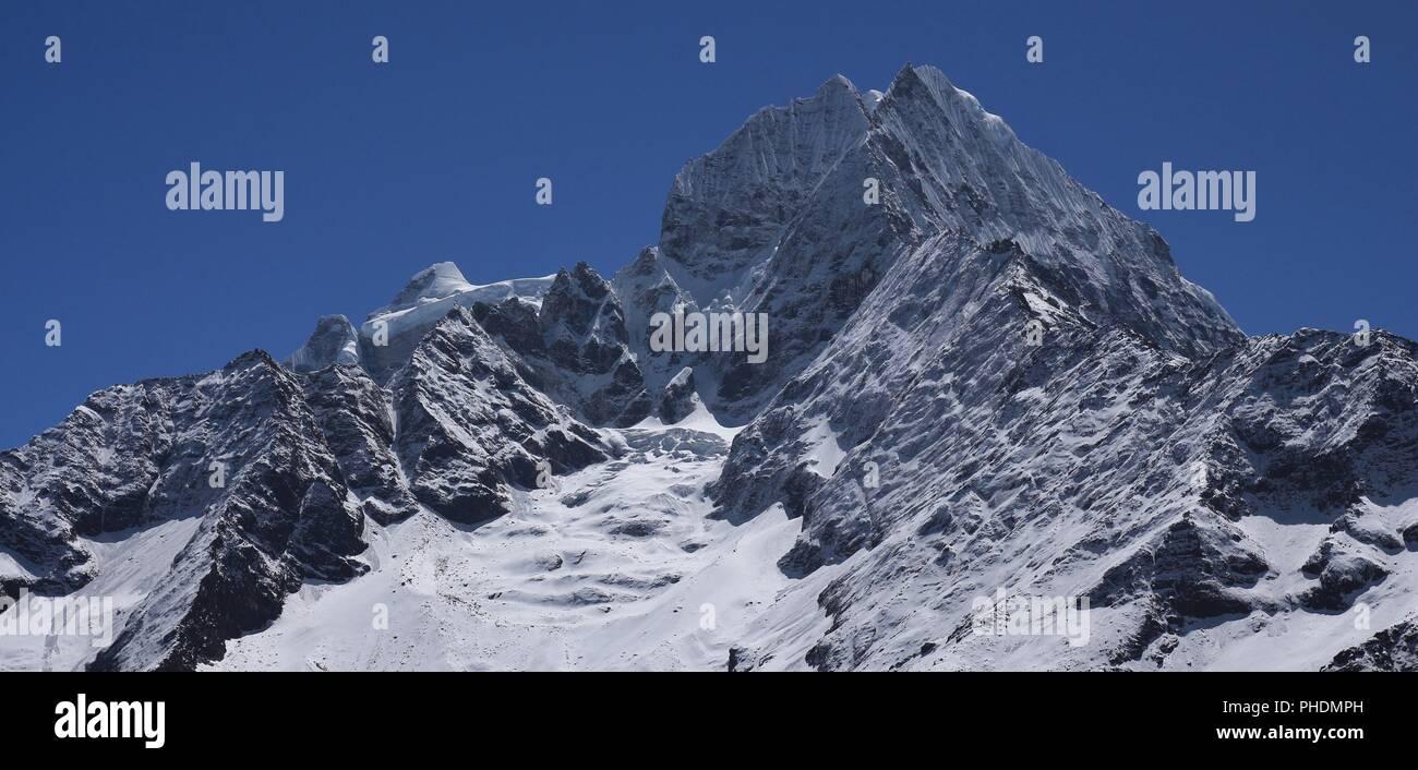 High mountains Kangtega and Thamserku. View from Khumjung, Nepal. - Stock Image