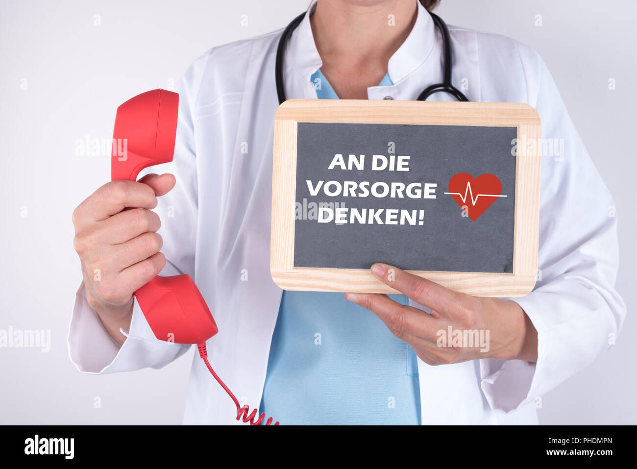 Doctor with telephone handset and sign in hand for prevention - Stock Image