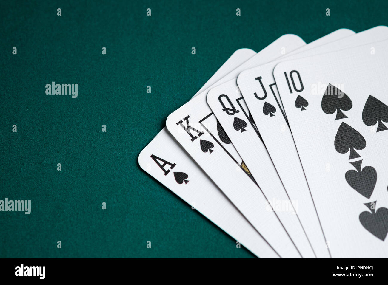 Royal Flush Combination Cards On Green Table For Poker Game Stock